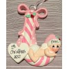 Baby cradled in a Candy Cane - Pink